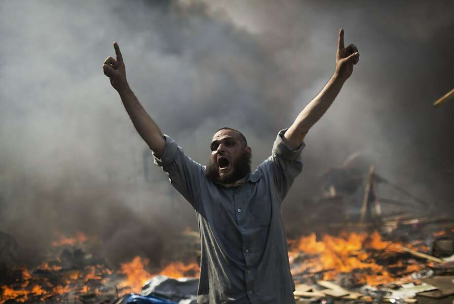 AP10ThingsToSee - A supporter of ousted Islamist President Mohammed Morsi shouts during clashes with Egyptian security forces in Cairo's Nasr City district, Egypt, Wednesday, Aug. 14, 2013. (AP Photo/Manu Brabo, File) Photo: Manu Brabo, Associated Press