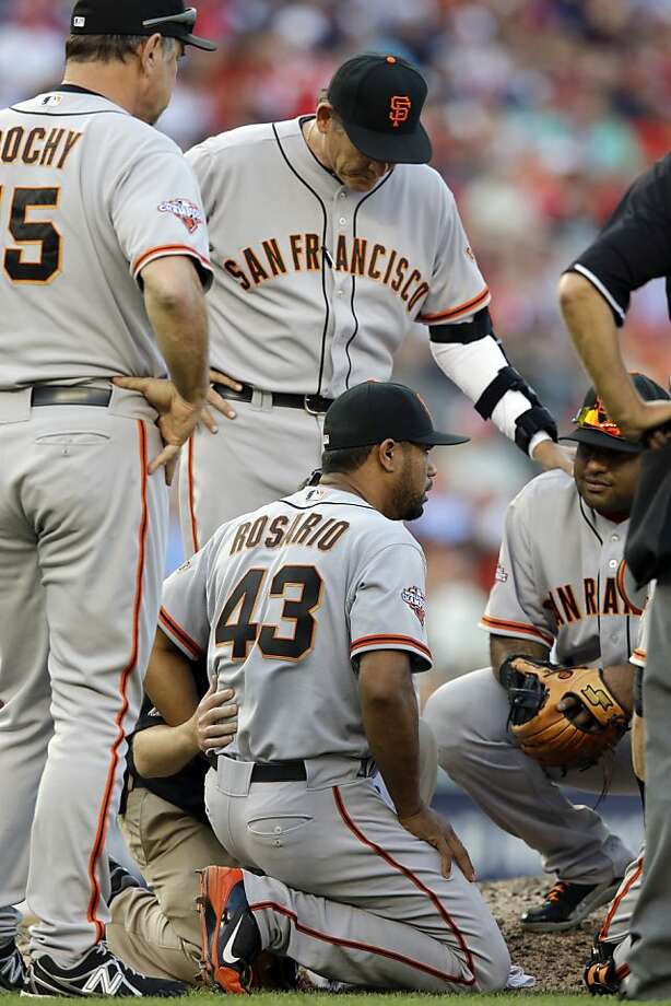 San Francisco Giants relief pitcher Sandy Rosario (43), center, is surrounded by his teammates, after being hit by the ball off the bat of Washington Nationals' Adam LaRoche during the seventh inning of a baseball game at Nationals Park Thursday, Aug. 15, 2013, in Washington. The Giants won 4-3. (AP Photo/Alex Brandon) Photo: Alex Brandon, Associated Press
