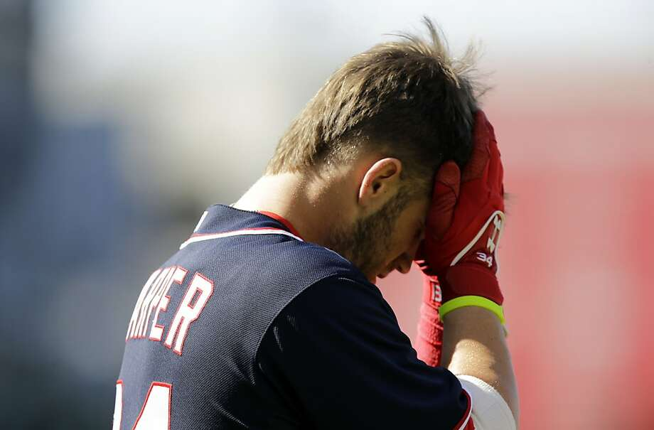 Washington Nationals left fielder Bryce Harper (34) pauses after striking out during a baseball game against the San Francisco Giants at Nationals Park Thursday, Aug. 15, 2013, in Washington. (AP Photo/Alex Brandon) Photo: Alex Brandon, Associated Press
