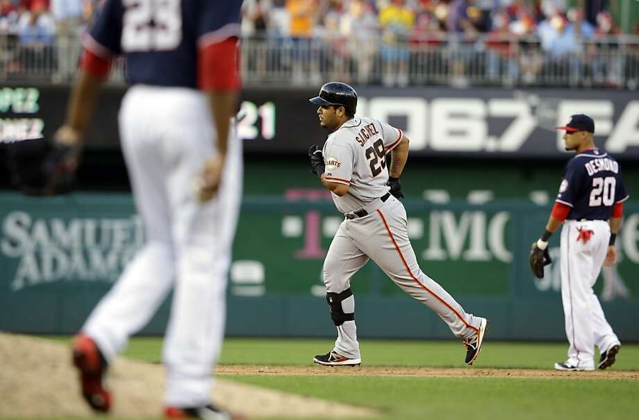 San Francisco Giants' Hector Sanchez (29) rounds the bases for his three-run homer during the ninth inning of a baseball game against the Washington Nationals at Nationals Park, Thursday, Aug. 15, 2013, in Washington. The Giants won 4-3. (AP Photo/Alex Brandon) Photo: Alex Brandon, Associated Press