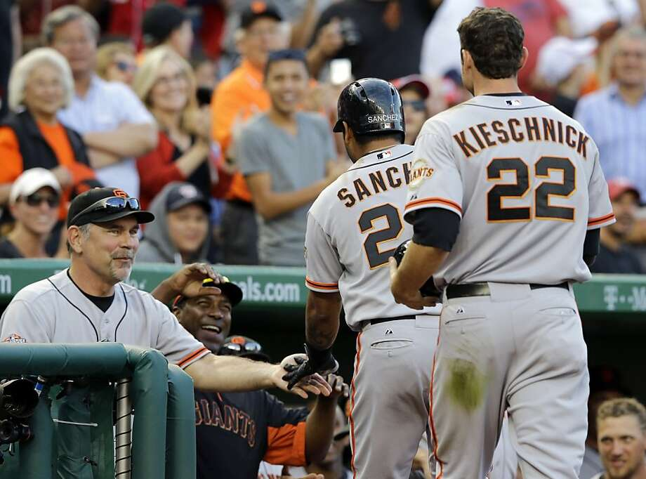 San Francisco Giants manager Bruce Bochy, left, celebrates with Hector Sanchez (29) after Sanchez's three-run homer during the ninth inning of a baseball game against the Washington Nationals at Nationals Park on Thursday, Aug. 15, 2013, in Washington. The Giants won 4-3. (AP Photo/Alex Brandon) Photo: Alex Brandon, Associated Press