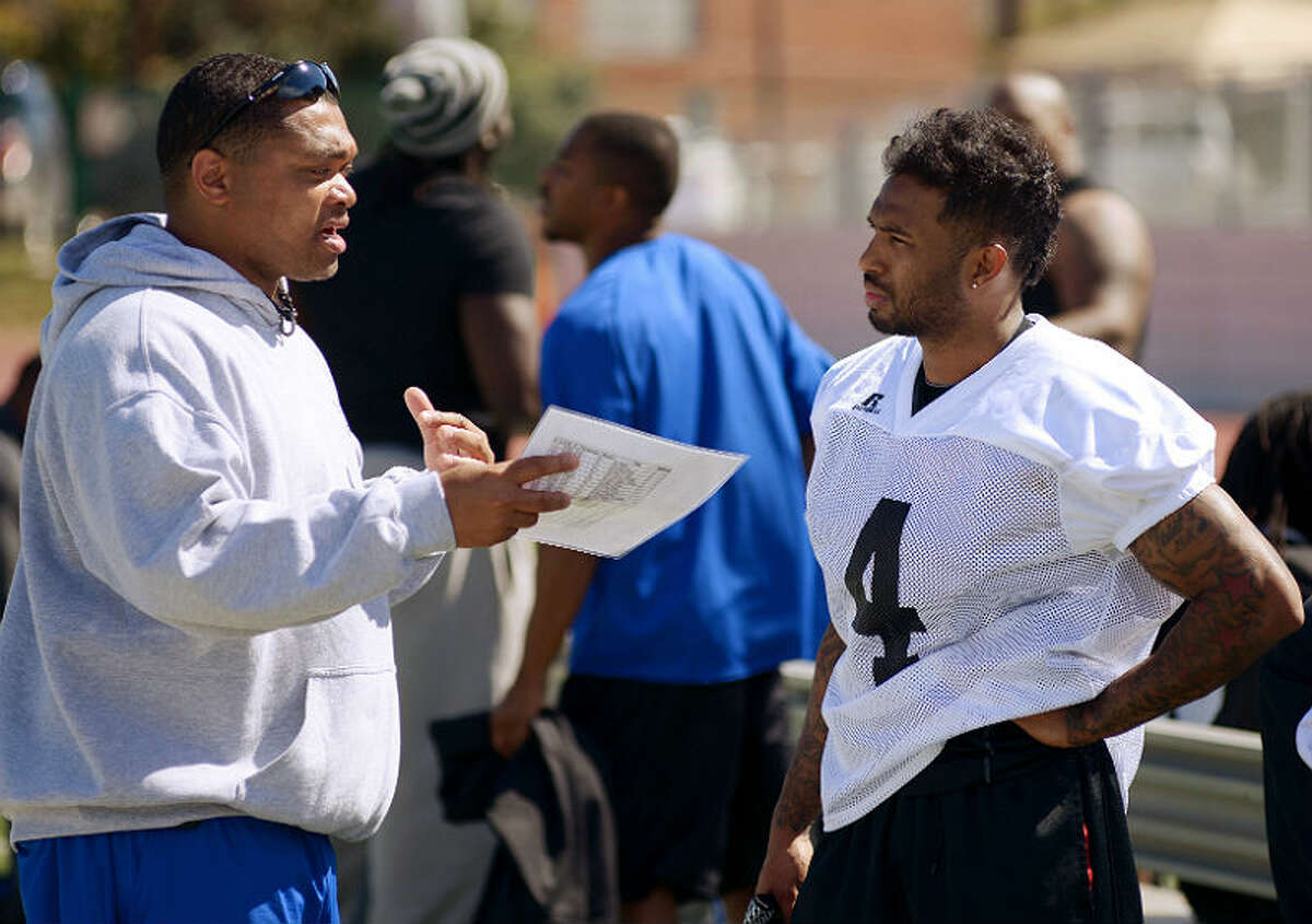 San Antonio Talons player Robert 'Bubby' Gill (right) talks toTalons offensive coordinator Ray Philyaw during a team practice on March 3, 2013. Gill is now trying to catch on with the Arizona Cardinals. (Darren Abate/For the Express-News)