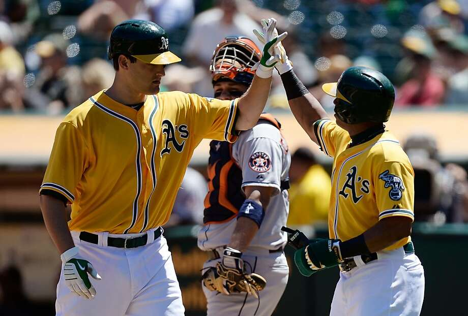 OAKLAND, CA - AUGUST 15:  Nate Freiman #7 and Yoenis Cespedes #52 of the Oakland Athletics celebrate at home plate after Freiman hit a two-run homer in the third inning against the Houston Astros at O.co Coliseum on August 15, 2013 in Oakland, California.  (Photo by Thearon W. Henderson/Getty Images) Photo: Thearon W. Henderson, Getty Images