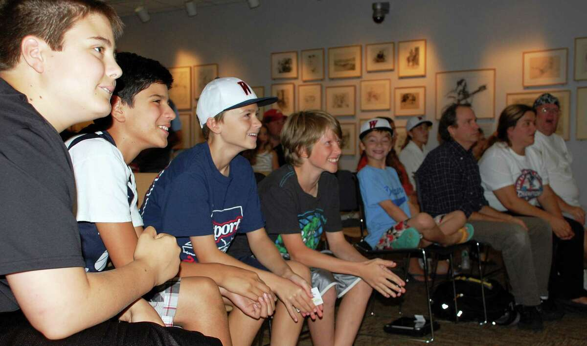 Fans at the Westport Library were literally on the edge of their seats Thursday as they watched the broadcast of the Westport Little League team's debut in the Little League World Series, taking a 3-2 lead into the final inning.