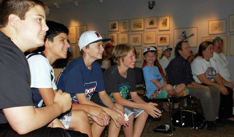 Fans at the Westport Library were literally on the edge of their seats Thursday as they watched the broadcast of the Westport Little League team's debut in the Little League World Series, taking a 3-2 lead into the final inning. Photo: Jarret Liotta / Westport News contributed