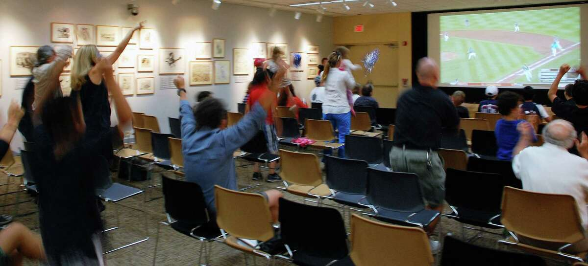 The McManus Room at the Westport Library is a blur of hometown excitement as fans cheered the 3-2 victory notched Thursday night by the Westport Little League team in the Little League World Series.