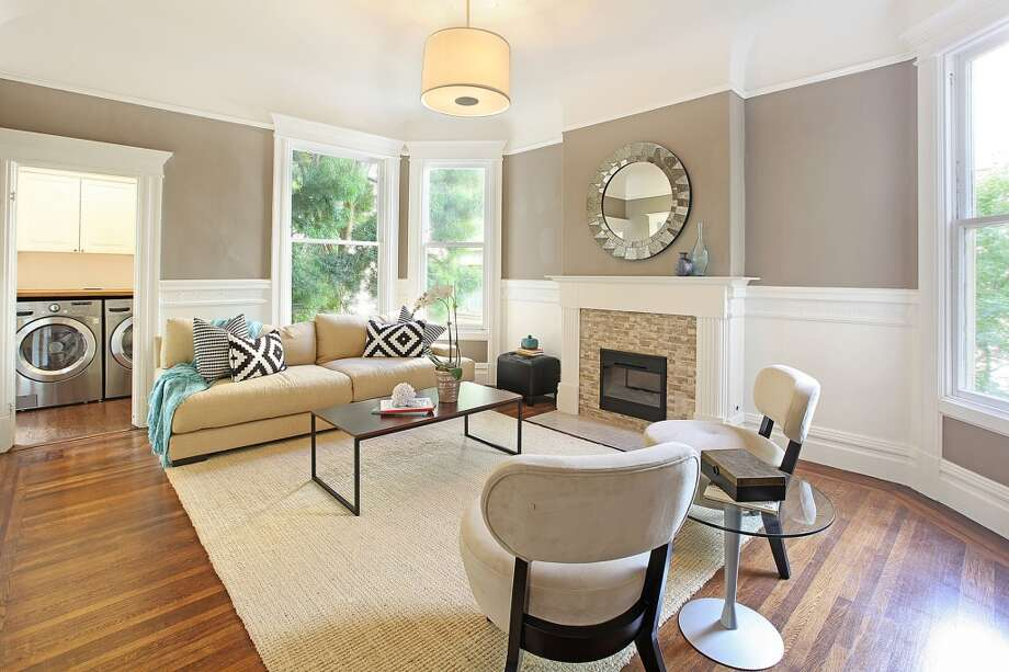 Both the living room and family room include a working fireplace. Photo: Lauren Cassidy