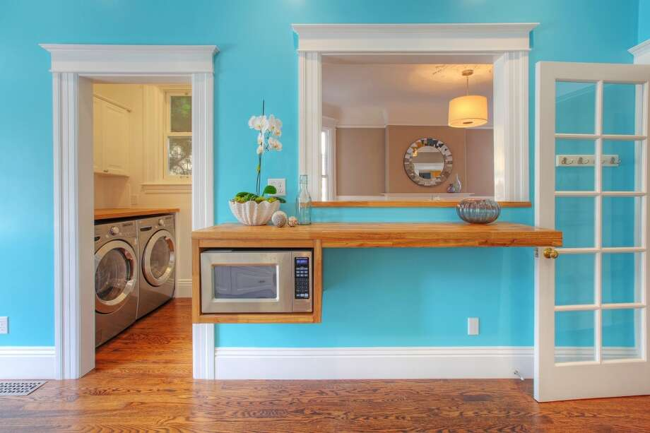 A washer and dryer are conveniently located down the hall from the kitchen. Photo: Lauren Cassidy