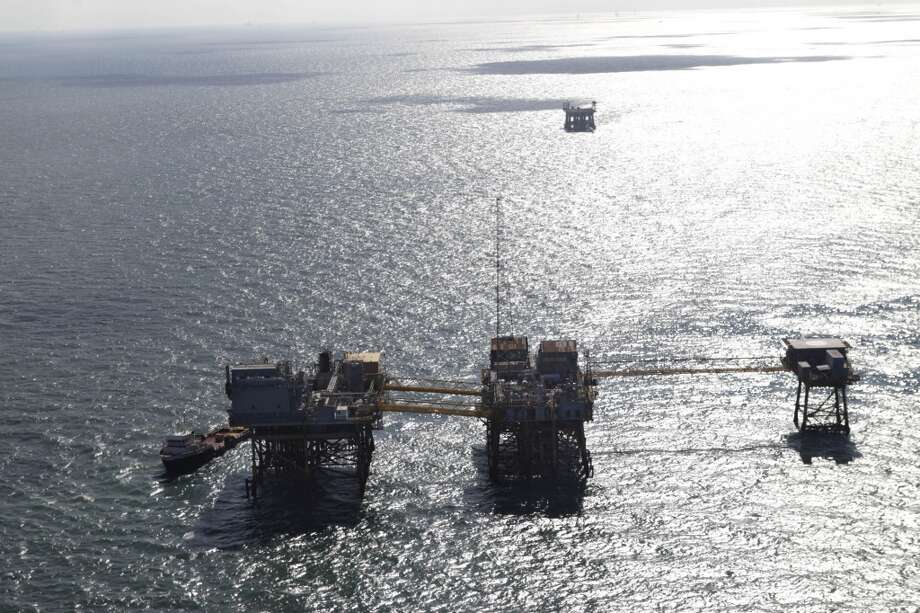 An oil platform damaged from an explosion and fire in the Gulf of Mexico, about 25 miles southeast of Grand Isle, La. Four people were transported to a hospital with critical burns and two were missing. Photo: Gerald Herbert, Associated Press