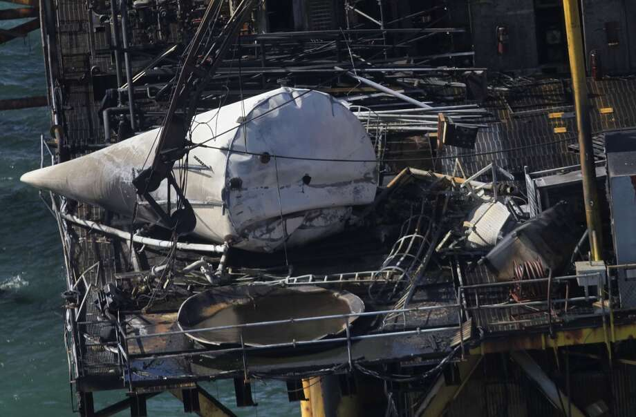 Damage from an explosion and fire on an oil platform in the Gulf of Mexico, Friday, Nov. 16, 2012. Four people were transported to a hospital with critical burns and two were missing. Photo: Gerald Herbert, Associated Press