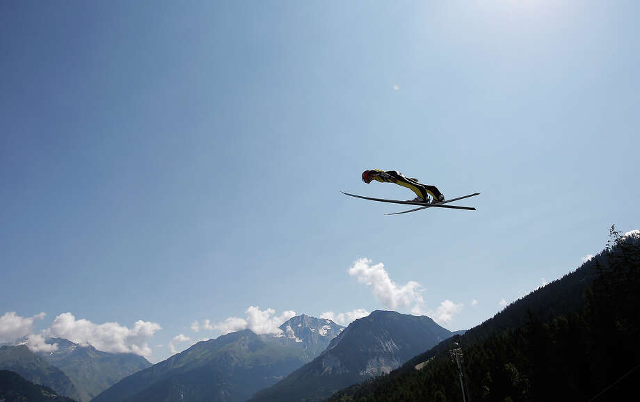 Skiiers from all over the world compete in the FIS Ski Jumping Grand Prix Mens in Courchevel, France ahead of the 2014 Winter Olympics in Sochi.Check out the action in this slideshow. Photo: Dean Mouhtaropoulos, Getty Images / 2013 Getty Images