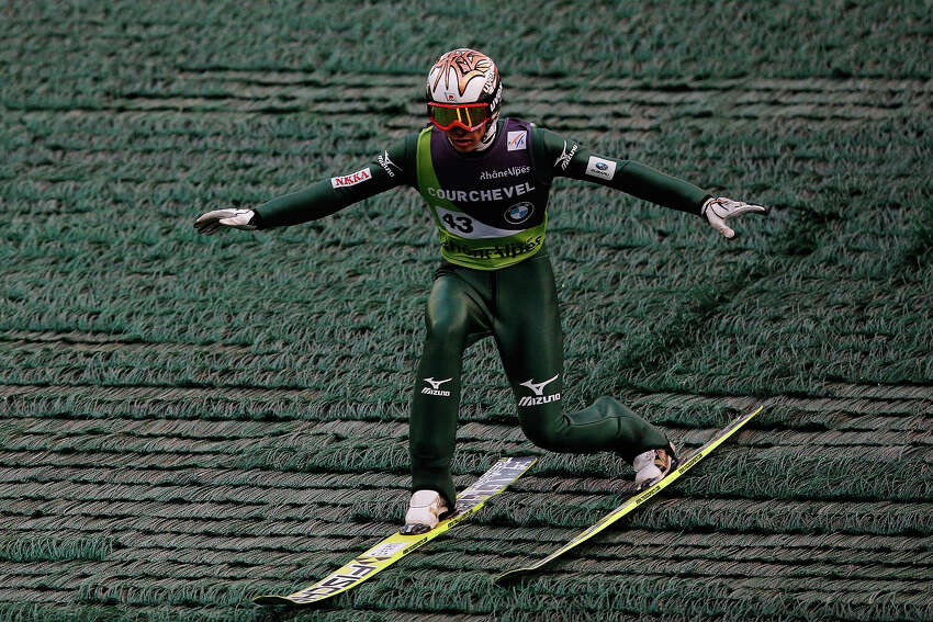 Taku Takeuchi of Japan llands his jump in the FIS Ski Jumping Grand Prix Mens Large Hill Individual Final on August 15, 2013 in Courchevel, France.