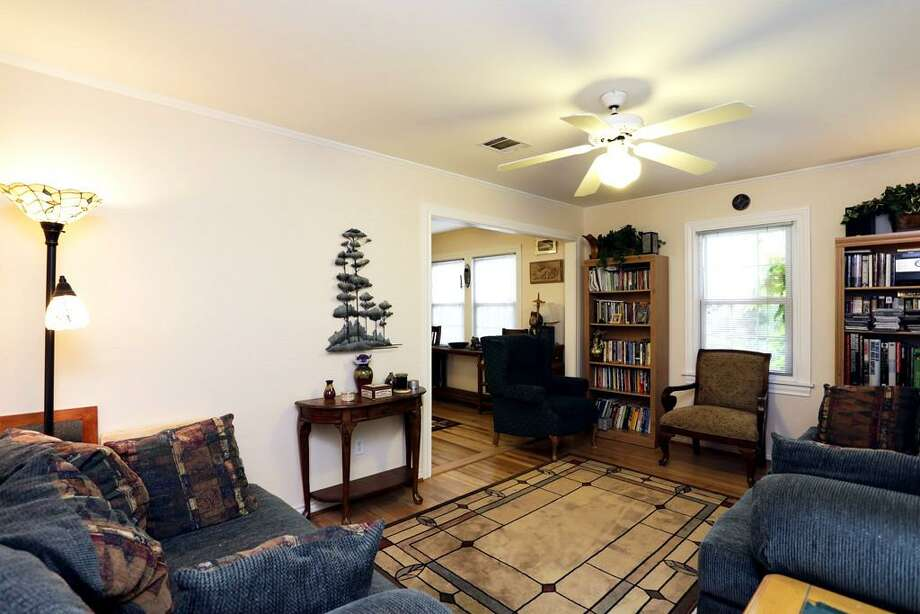 This home features three bedrooms and two bathrooms in more than 4,400 square feet of living space. The home also comes with plenty of room in the heart of the Heights.