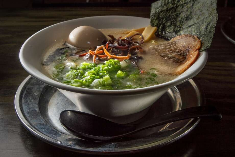 The Orenchi Ramen ($9) consists of a pork-rich tonkotsu broth, topped with soft boiled egg, pork, green onion, bamboo shoots, mushroom, sesame and nori. Photo: John Storey, Special To The Chronicle