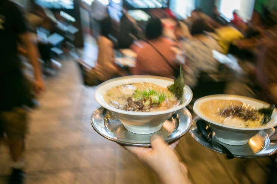 Ramen being carried to tables during lunch at Orenchi Ramen in Santa Clara. Photo: John Storey, Special To The Chronicle