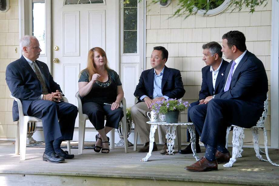 State Representative (D-147, Stamford) and Democratic mayoral candidate William Tong meets with homeowner Cheryl Richter at her Stamford, Conn. home on Friday August 16, 2013 to discuss her mortgage foreclosure that is now in mediation also present are (left to right) Rey Giallongo, CEO First County bank, State Senator Carlo Leone and Richter's lawyer Jon Hoffman. Photo: Dru Nadler / Stamford Advocate Freelance