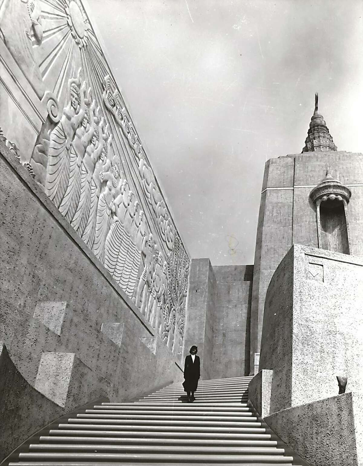 Date unknown - This beautiful stairway leads to one of the East Towers which look out over the main lagoon and the Court of the Nation on Treasure Island, San Francisco Bay site of the 1939 Golden Gate International Exposition. On the wall is Jacques Schnier's bas relief,