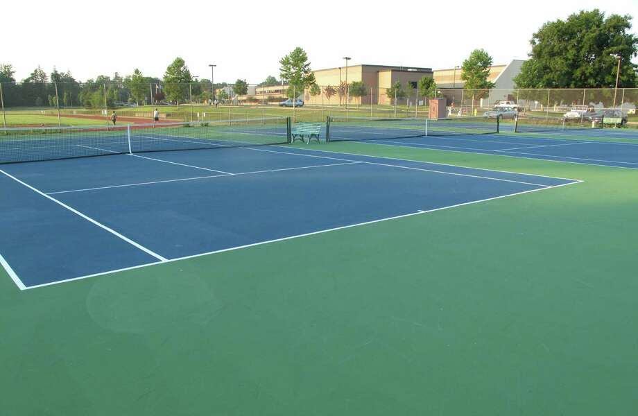 An appropriation for the replacement of six tennis courts at New Canaan High School failed to be approved by the Town Council on Thursday, Aug. 15, 2013. Photo: Tyler Woods