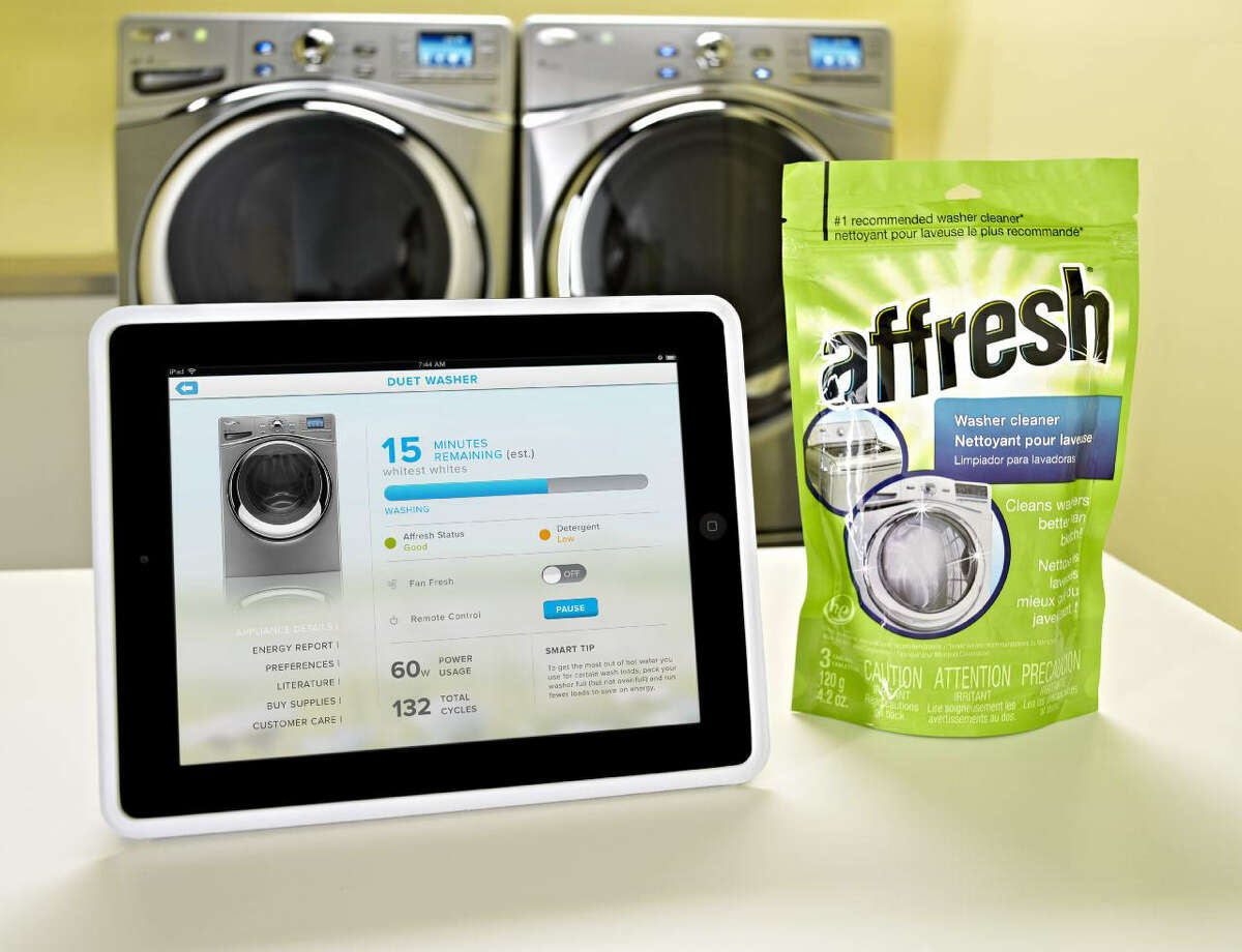 Whirlpool's smart washer and dryer can be controlled with the My Smart Appliances app, shown on an iPad.