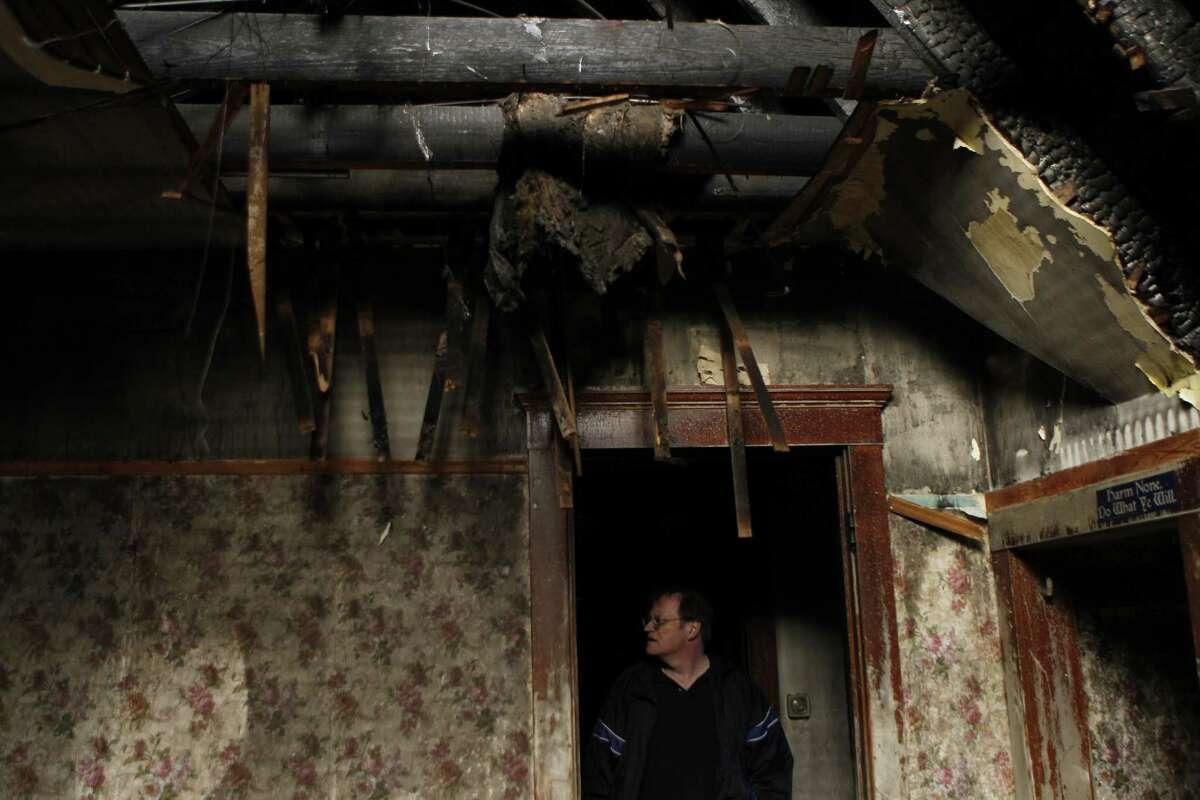 Chicago Tribune reporter Bill Hageman has a look around the third floor of his fire-damaged house in Aurora, Ill.