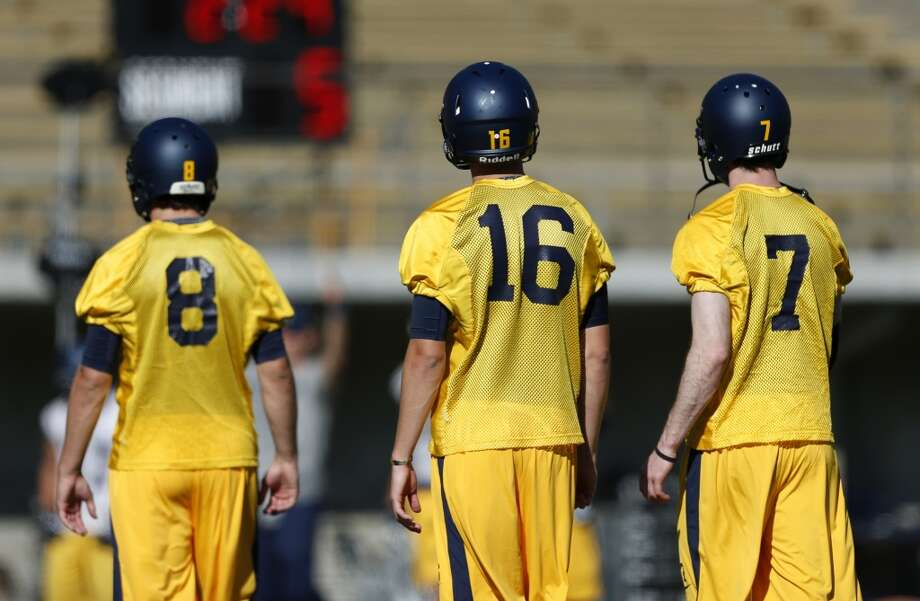 Calfootball quarterbacks Zach Kline (8), Jared Goff (16) and Austin Hinder (7) at practice at Memorial Stadium in Berkeley on Monday, August 5, 2013 in Berkeley, Calif. Photo: Beck Diefenbach, Special To The Chronicle