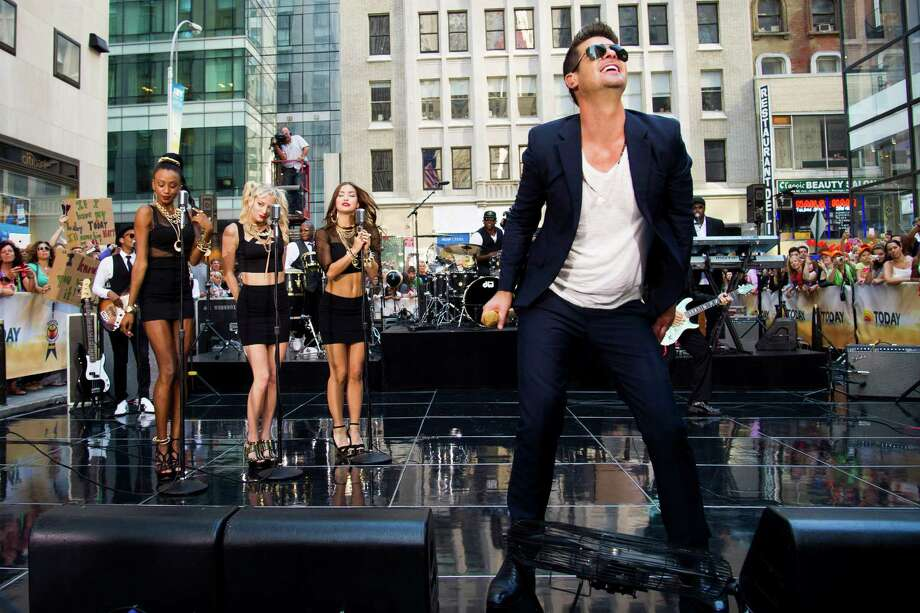 "FILE - Robin Thicke performs on NBC's ""Today"" show in New York on Tuesday, July 30, 2013. The video for his song ""Blurred Lines,"" where topless models playfully dance around him, has stirred a debate, with detractors complaining that it's too racy and degrading to women. Thick insists he meant no offense - and the song, meanwhile, has become the No. 1 hit of the summer. (Photo by Charles Sykes/Invision/AP) ORG XMIT: NY871 Photo: Charles Sykes / Invision"