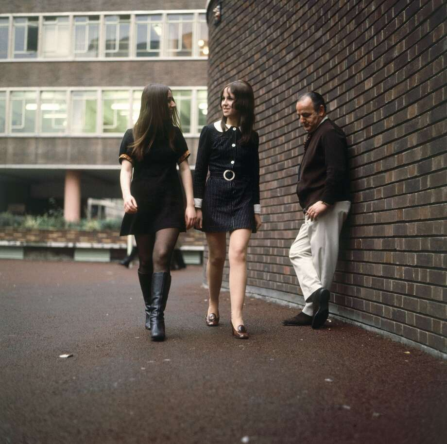 Two young women wearing miniskirts pass by a puzzled onlooker on a London street  In 1967. Photo: Keystone-France, Gamma-Keystone Via Getty Images