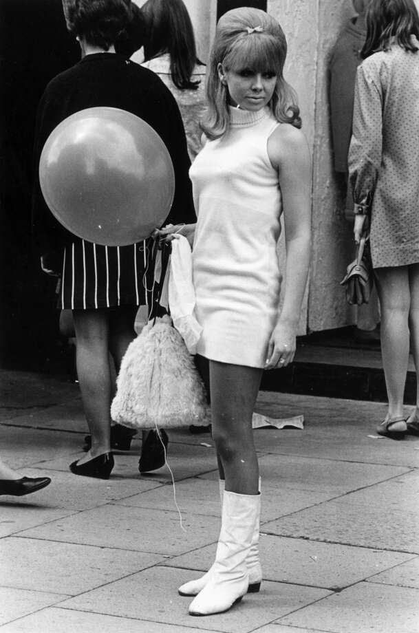 A young  woman wearing a mini dress in 'swinging' London. Photo: Tim Graham, Getty Images