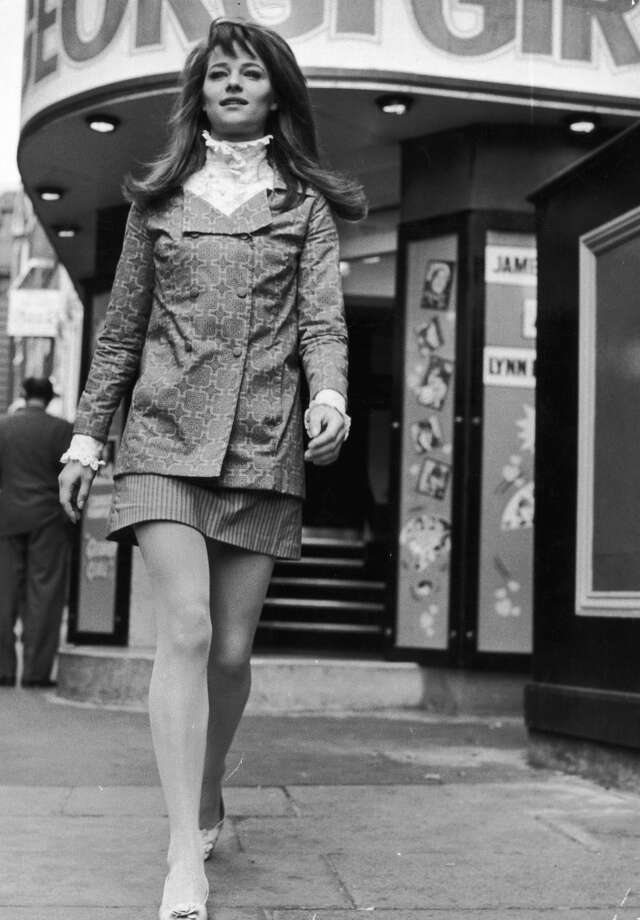 Actress Charlotte Rampling wears a high-collared Edwardian-style shirt under a double breasted jacket. Her mini-skirt is in contrasting stripes. Photo: Richard Chowen, Getty Images