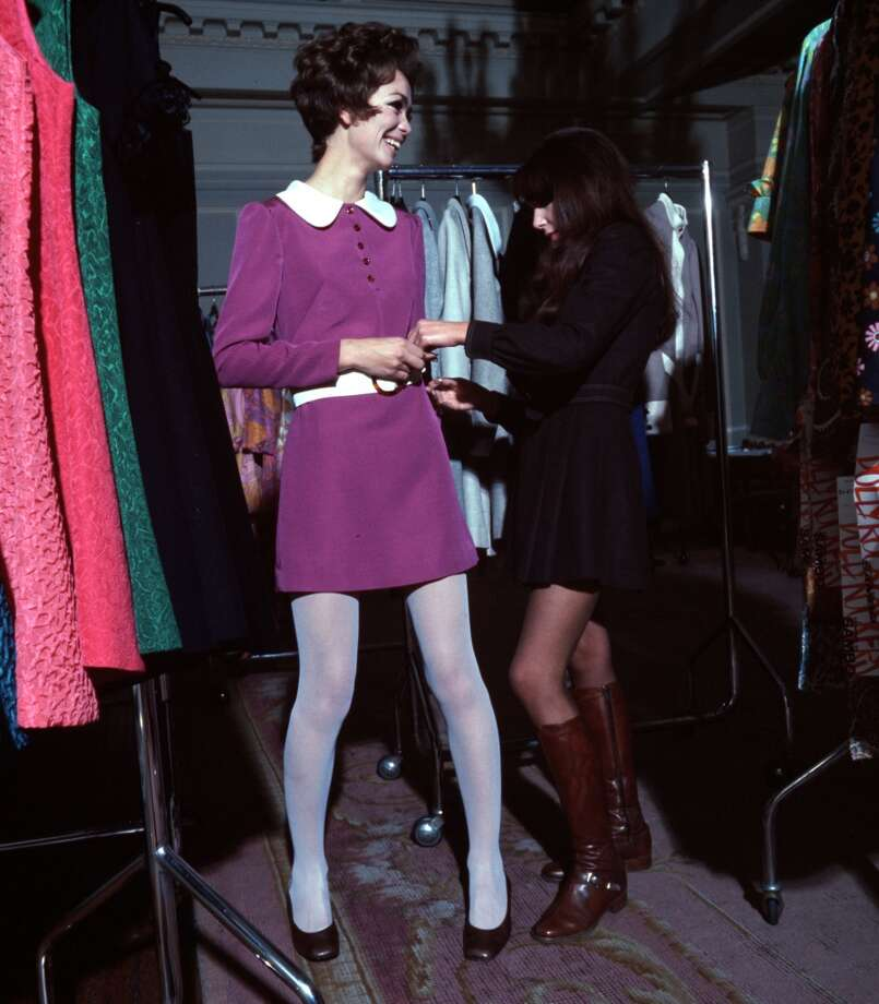 A girl is pictured being fitted for a mini dress at a clothes shop in 1968. Photo: Popperfoto, Popperfoto/Getty Images