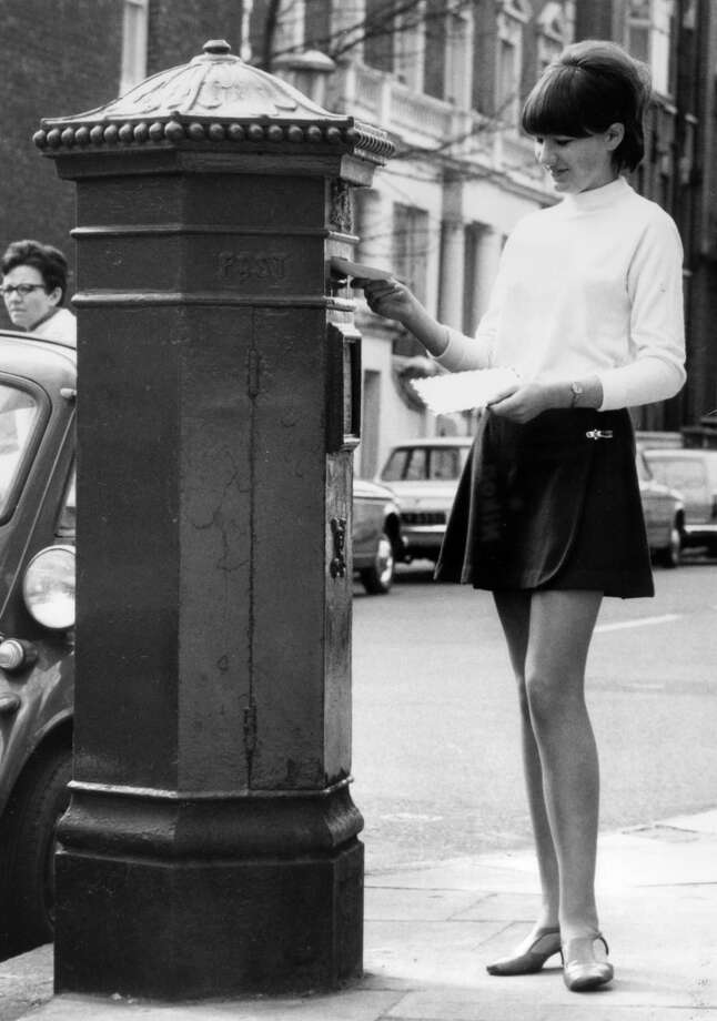 Young woman dressed in a miniskirt posts a letter in Chelsea, London in 1968. Photo: Popperfoto, Popperfoto/Getty Images