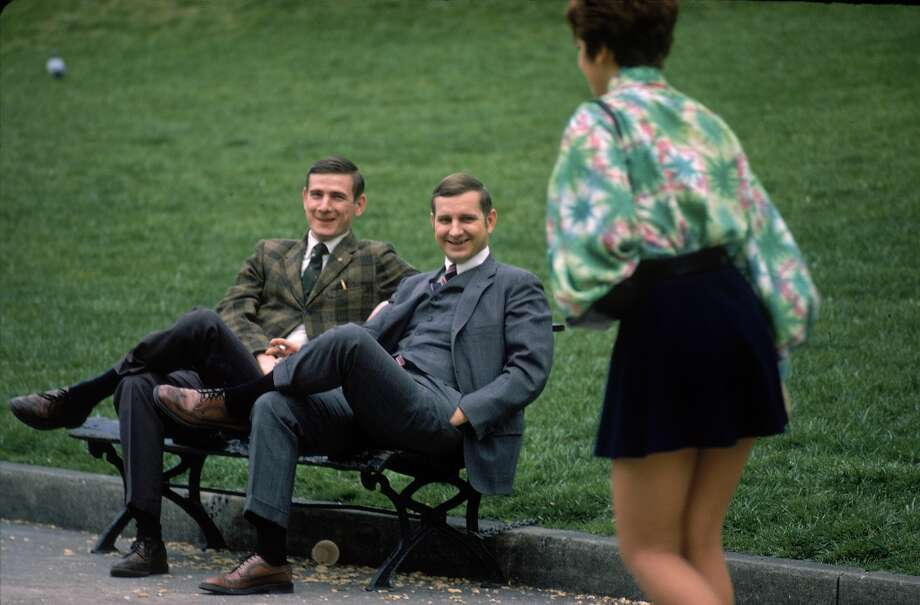 Two young businessmen eyeing a woman wearing a mini-skirt on one of the first warm days of spring in 1970. Photo: Michael Mauney, Time & Life Pictures/Getty Image