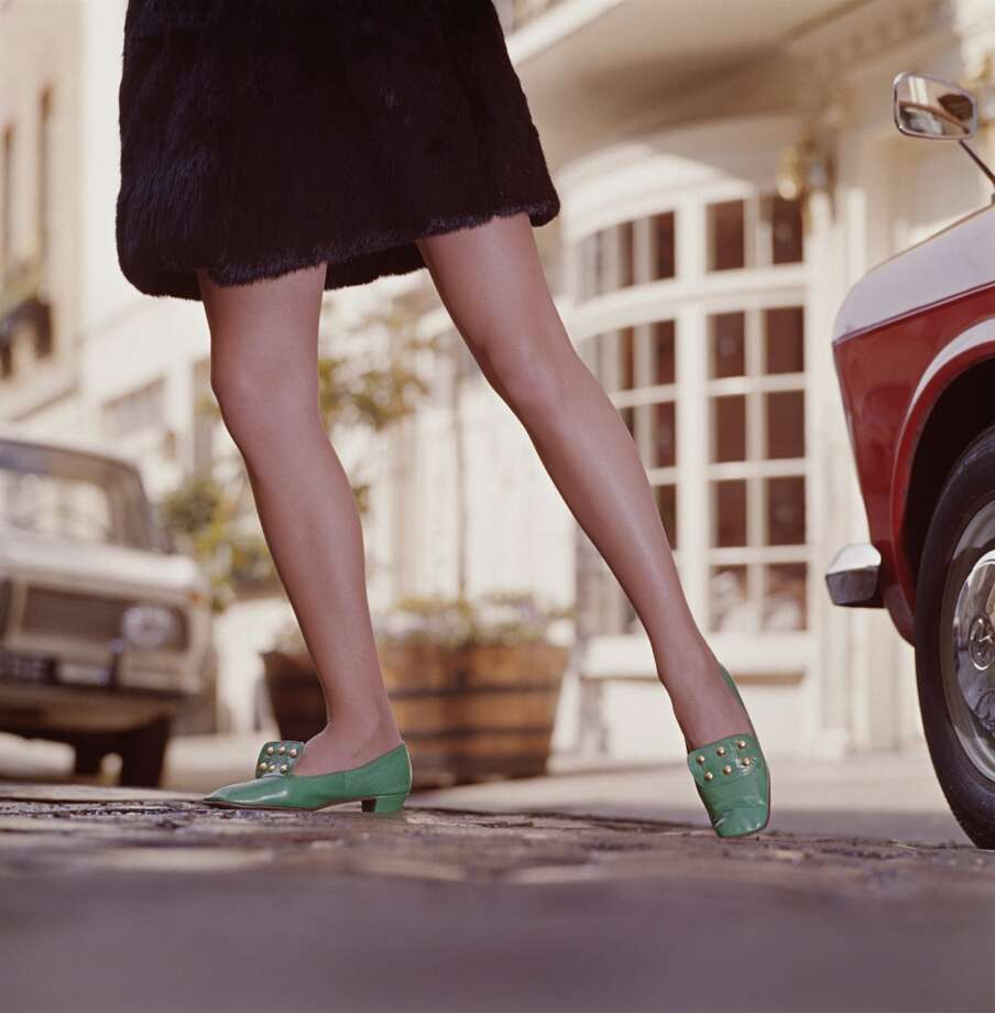 A young woman in green shoes wearing a faux fur miniskirt, circa 1970. Photo: Jamie Hodgson, Getty Images