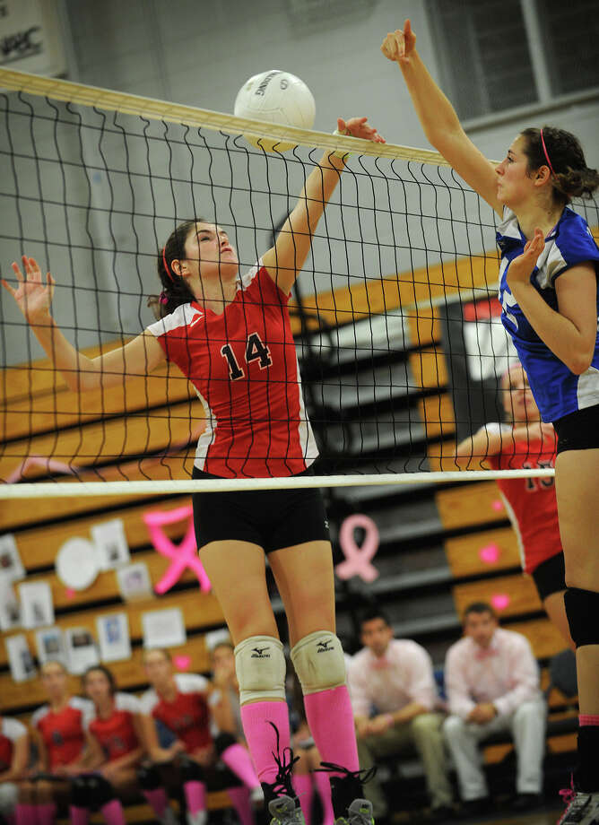 Warde's Kaitlin McKenna, left, pictured during a 2012 match, will be one the Mustangs' three girls volleyball captains in 2013. Photo: Brian A. Pounds / Connecticut Post