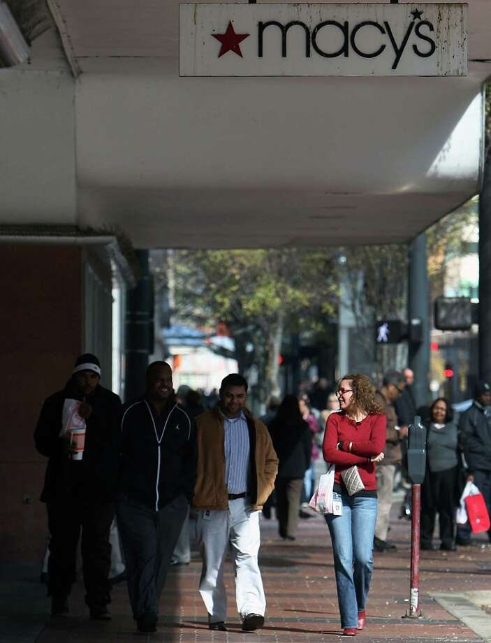 Pedestrians walk by Houston's Macy's before it closed. Photo: James Nielsen, Chronicle / © Houston Chronicle 2012