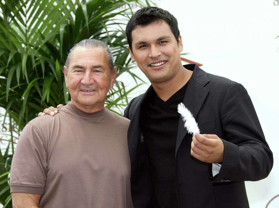 "Monaco, MONACO: US actor Adam Beach (R) and US actor August Schellenberg (L) pose, 11 June 2007 during a photocall for the television serie ""Bury My Heart at Wounded Knee"" at the 47th Monte Carlo Television Festival in Monaco. Monte Carlo Television Festival, held since 1961, aims at encouraging the new art form of television.   AFP PHOTO  VALERY HACHE Photo: VALERY HACHE, AFP/Getty Images / 2007 AFP"