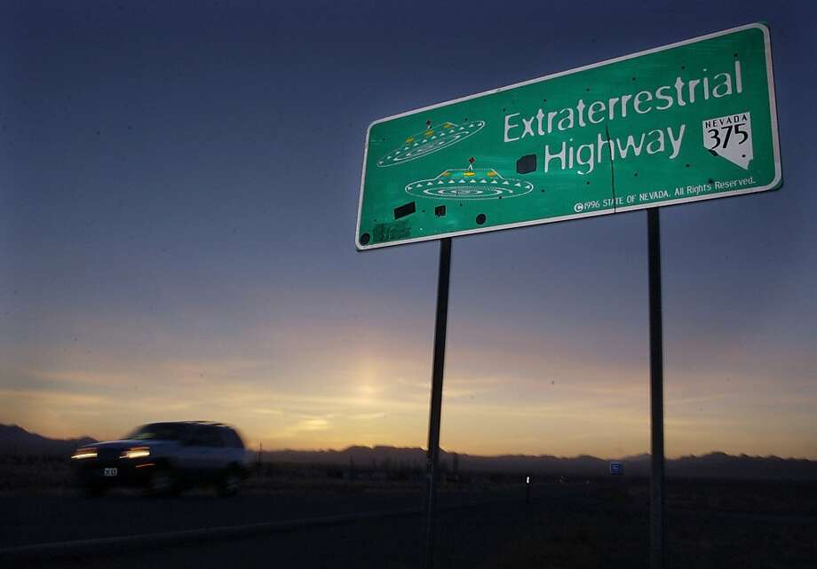 A car moves along the Extraterrestrial Highway near Rachel, Nevada, in this Wednesday, April 10, 2002 file photo. The ET highway was established by the Nevada Legislature in 1996 and runs along the eastern border of Area 51, a military base on the Nevada Test Site. George Washington University's National Security Archive obtained a CIA history of the U-2 spy plane program through a public records request and released it Thursday Aug. 15, 2013. (AP Laura Rauch, File) Photo: Laura Rauch, Associated Press
