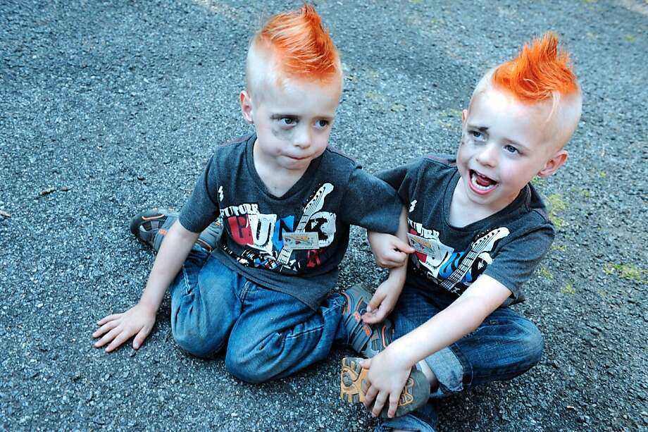Double trouble:Among the twins taking part in the Fete des Jumeaux (Festival of Twins), a gathering of   twins, triplets and quadruplets in Pleucadeuc, France, are these two fauxhawk   punksters. Photo: Fred Tanneau, AFP/Getty Images