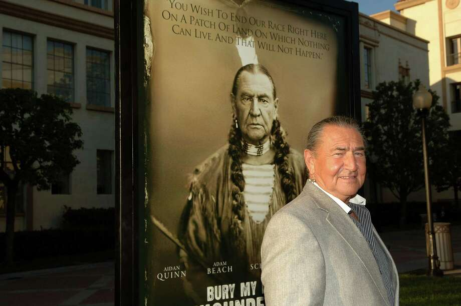 "HOLLYWOOD - MAY 10:  Actor August Schellenberg poses with the movie's poster showing his  picture at the Los Angeles premiere of HBO's ""Bury My Heart At Wounded Knee"" at Paramount Pictures Studio on May 10, 2007 in Hollywood, California.  (Photo by Stephen Shugerman/Getty Images) *** Local Caption *** August Schellenberg Photo: Stephen Shugerman, Getty Images / 2007 Getty Images"