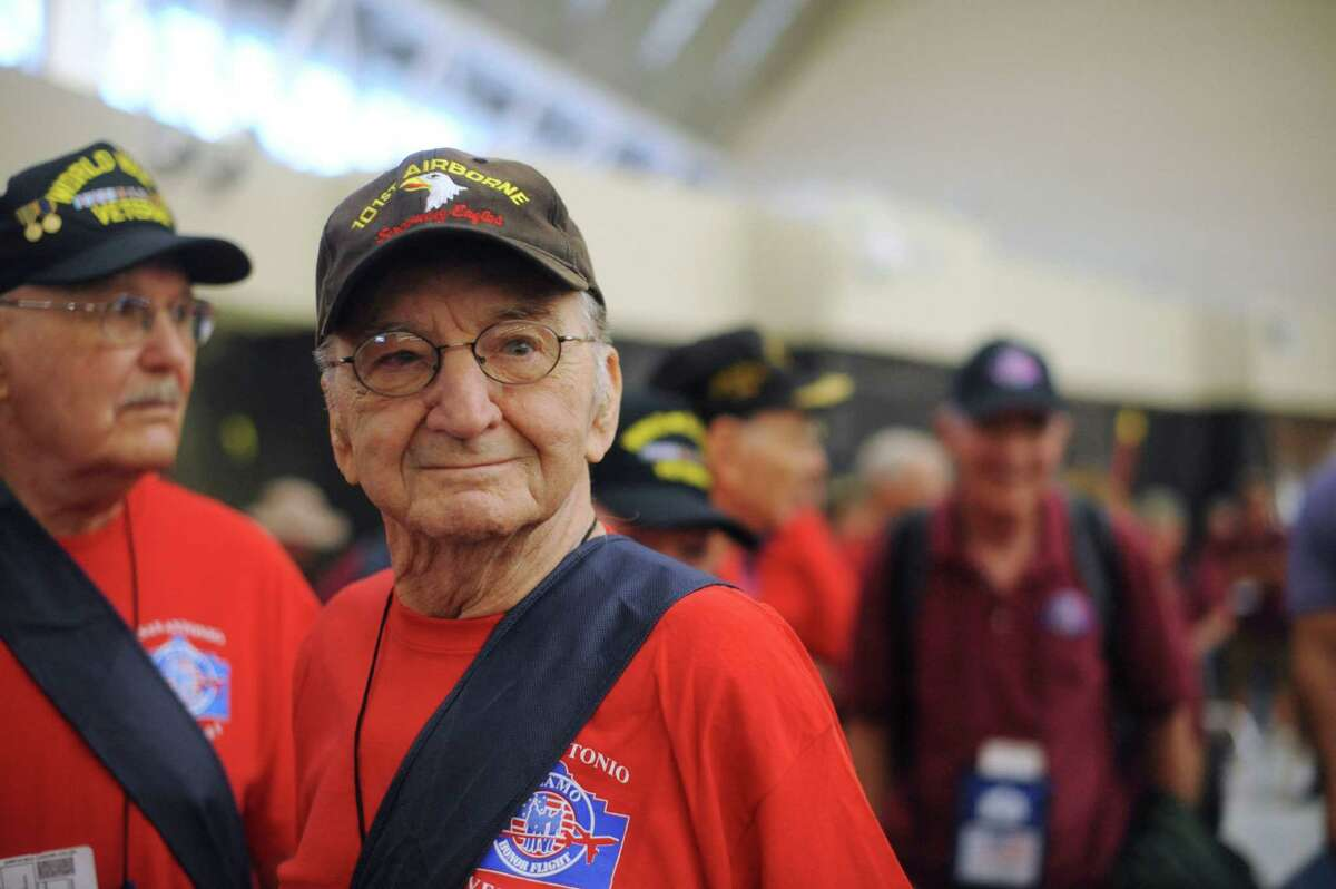 World War II veteran Ben Potts, who was in the Airborne and participated in the Battle of the Bulge, stands with other veterans at San Antonio International Airport to take the last Alamo Honor Flight to Washington D.C. on Friday, Aug. 16, 2013. About 300 World War II veterans have received all-expense-paid trips to Washington since 2010 under the program, which is ending.
