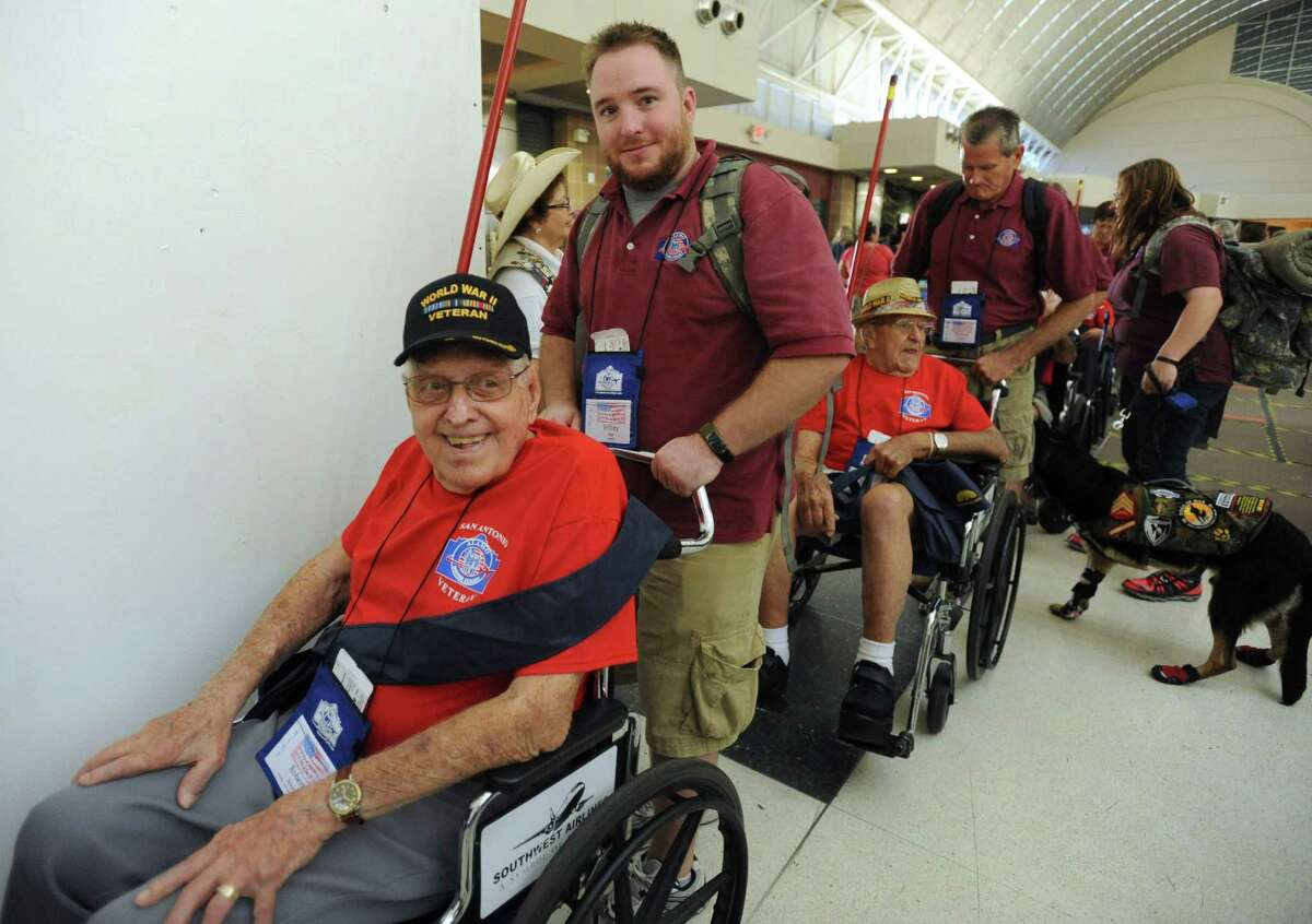 World War II veteran Robert Streit and others prepare to take the last Alamo Honor Flight to Washington D.C. at San Antonio International Airport on Friday, Aug. 16, 2013. About 300 World War II veterans have received all-expense-paid trips to Washington since 2010 under the program, which is ending.
