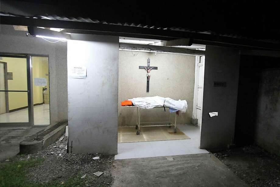 A body lies in a morgue at the hospital at a hospital in Cebu after a ferry collided with a cargo ship in Cebu, central Philippines on August 17, 2013. At least 17 people died while nearly 600 others were rescued after a ferry collided with a cargo ship in the Philippines on Friday, authorities said. The Thomas Aquinas ferry, which was believed to be carrying about 700 passengers, sank quickly after colliding with a freighter near the port of Cebu, the country's second biggest city, coastguard spokesman Commander Armando Balilo said. Photo: Chester Baldicantos, AFP/Getty Images