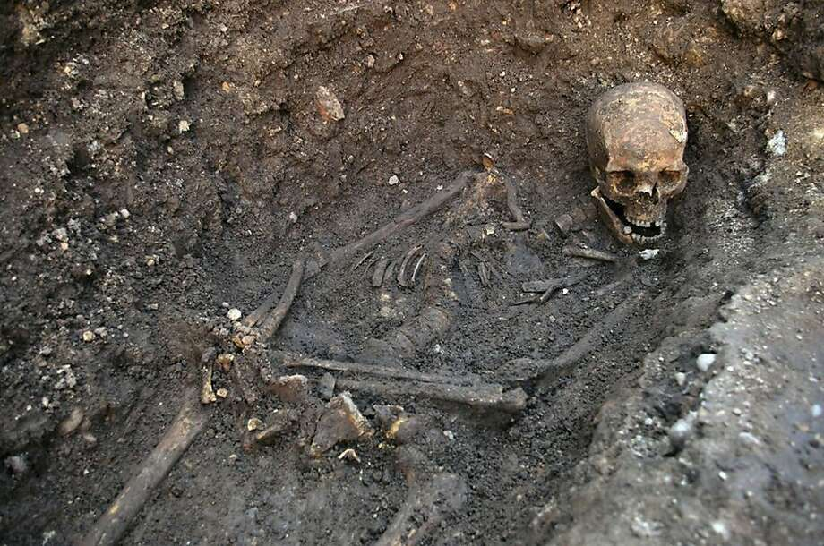 "This is an undated file photo released by the University of Leicester, England, of remains found underneath a car park in September 2012 in Leicester, which have been declared ""beyond reasonable doubt"" to be the long lost remains of England's King Richard III, missing for 500 years. A British High Court judge on Friday Aug. 16 2013 granted a group of Richard's relatives the right to challenge plans to rebury the 15th-century monarch in the city of Leicester. Judge Charles Haddon-Cave said the Plantagenet Alliance could take action against the government and the University of Leicester. A hearing is due later this year. The government has given Leicester Cathedral a license to rebury the king, but the relatives' group wants him buried in the northern England city of York, claiming it was the king's wish. Richard was killed in battle in 1485. His skeleton was found last year under a Leicester parking lot. Photo: University Of Leicester, Associated Press"
