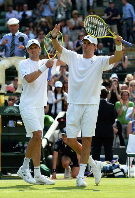Twins Bob Bryan, left, and Mike Bryan are doubles stars, but the team-tennis sport gets no love from fans. Photo: Mike Hewitt, Staff / 2013 Getty Images