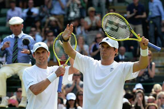 Twins Bob Bryan, left, and Mike Bryan are doubles stars, but the team-tennis sport gets no love from fans.