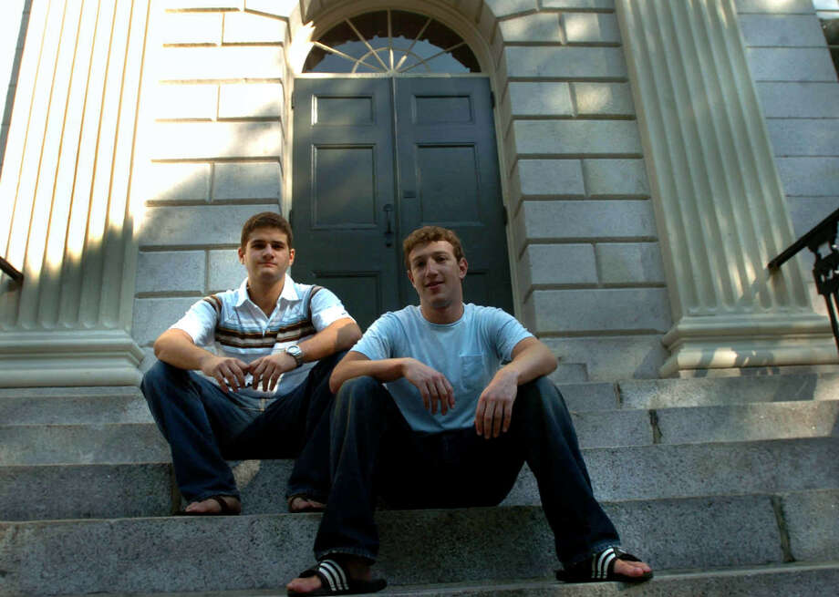 Here, Mark Zuckerberg and Dustin Moscovitz pose at Harvard Yard in 2004, after they took time off to focus on Facebook. Photo: Boston Globe, Boston Globe Via Getty Images / 2011 - The Boston Globe