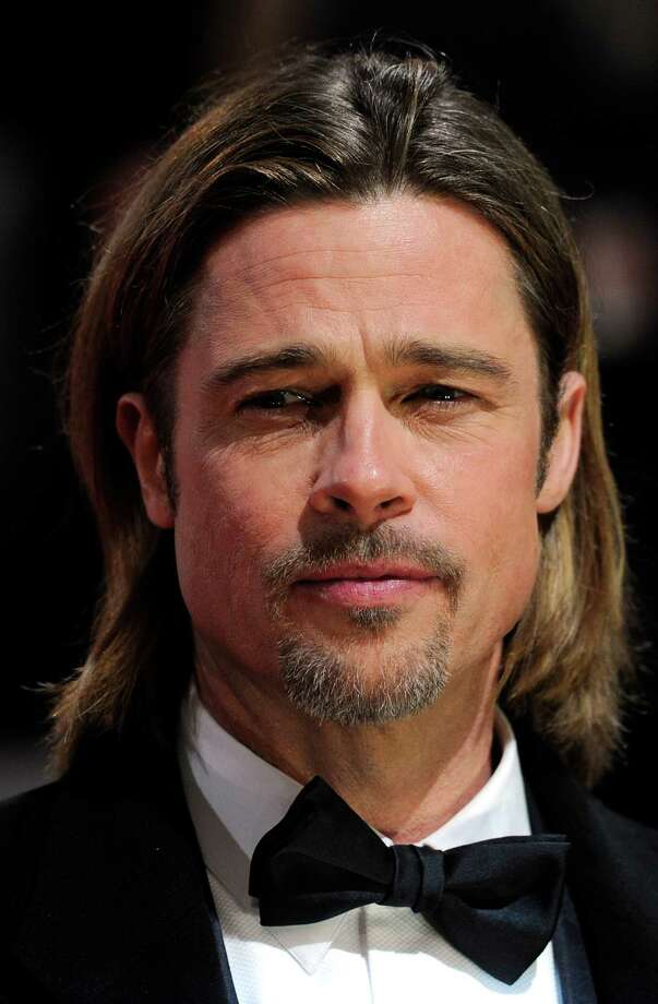 "Brad Pitt scored big  on the red carpet in 2011 playing Billy Beane in ""Moneyball"". Photo: CARL COURT, AFP/Getty Images / AFP"