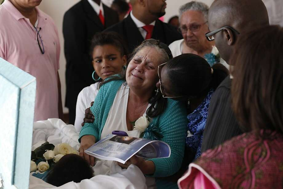 Grandmother Dolores Padilla is comforted by family and friends at the service for 16-month-old shooting victim Drew Jackson at Fuller Funeral Home in Oakland. Photo: Lacy Atkins, The Chronicle