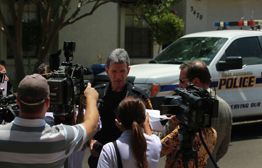 San Antonio Police Chief William McManus (center, facing) speaks with the media Friday August 16, 2013 at the scene of an apparent murder suicide that took place shortly after noon on the city's North Side. McManus said a 61-year-old male and a 60-year-old female were found dead in the home after a call received by police told them there had been a shooting. The home is located in the River Oaks subdivision. The scene is still being investigated by police.