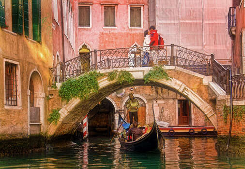Took my wife to Italy for her birthday, and saw this happen in a flash while on a gondola ride in Venice. The right time at the right place; just lucky!